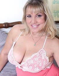 Curvy Danielle T lounges on the bed sliding out of her nightie looking sexy