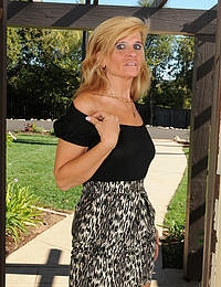 49 year old blonde Crystal Jewels sprerading her ass in the backyard