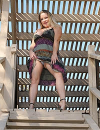 Busty 30 year old MILF Allyza Blue gets down and dirty outdoors