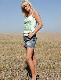 Blonde 43 year old Jenny F undresses and spreads wide in the field