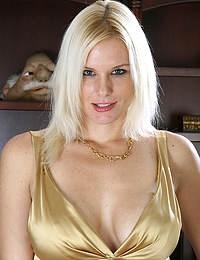 Elegant blonde MILF Slovanna slips off her dress to show off her tits