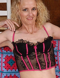 Blonde MILF shows perfect pussy under her lingerie