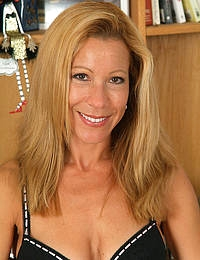 Athletic MILF slips out of the tightest black lingerie