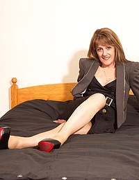 Naughty mature lady getting ready to play with herself