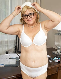 Mature Ashlea is working late at the office when she gets horny she just starts playing with her self