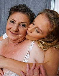 Hot babe getting caught by her big breasted aunt while masturbating