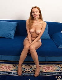 Naughty skinny MILF playing with her wet pussy