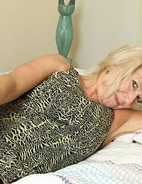 Naughty British mature lady getting wet in bed