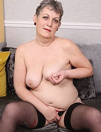 Naughty older lady playing with her pussy