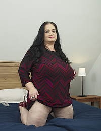 Huge breasted mature lady playing with her pussy