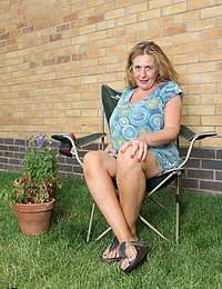 Naughty Camilla gets frisky in her garden