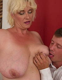 Big breasted curvy mature lady doing her younger lover
