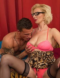 Naughty mature temptress having fun with her toy boy