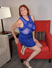 American mature lady playing with all of her toys