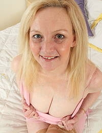 Naughty British housewife showing off her nice rack and then some