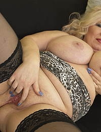 Naughty big breasted mature BBW playing with herself