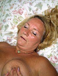 Cum On Grannys Big Fake Tits