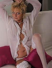 Blonde mature slut masturbating
