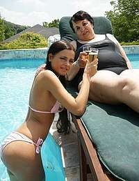 Horny mature slut getting nasty with a hot babe by the pool