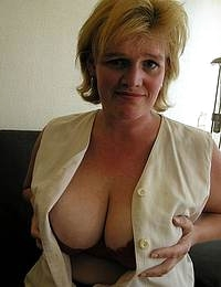 See this blonde mature slut playing with her cunt and tits