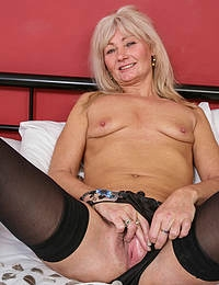 Naughty British housewife getting herself steamy and wet