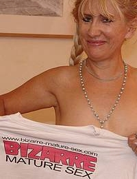 Blonde mature slut fucking herself with a bat