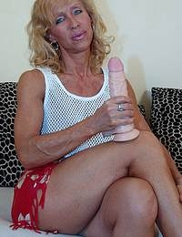 Horny blonde mature playing on the couch