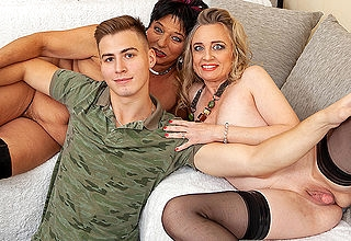Twosome horny housewives share their young toyboys cock encircling hot trinity