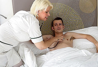 Horny mature nurse gives her young tempt a prepare patient a very gut treatment