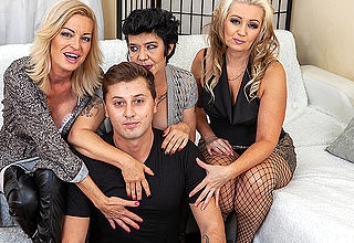 Three cougars seduce a young scrounger on the couch be expeditious for steamy groupsex