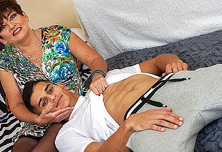 Toyboy fucking a hairy mature nympho on the couch