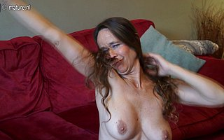 Hairy British housewife playing thither her muff