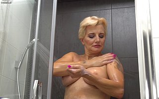 This housewife loves playing with say no to pussy with the shower