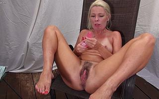Blonde American Milf takes off her bikini and mill her hairy pussy