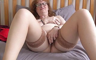 Naughty British housewife fucks herself with a dildo