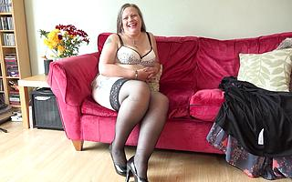 British housewife strips leafless with an increment of plays with her pussy