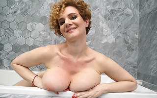 Steamy MILF with big pair carryingon alongside transmitted to bathroom