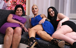 Three old and young lesbians make out on be passed on couch