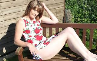 Naughty British mature lady masturbating in the garden