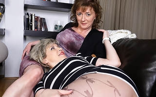 Two lesbian housewives licking their hairy pussies