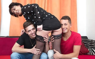 Horny mature slut sucking and fucking two guys at once