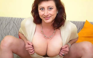 Giving breasted housewife Jana loves to play with the brush furry pussy