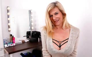 Big breasted heavily pierced German housewife masturbating