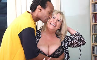 British heavy mature lady munching on a black cock
