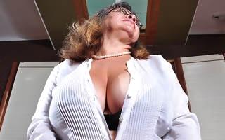 Big breasted mature slut playing surrounding herself