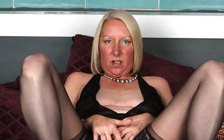 Horny blonde housewife playing with her wet pussy