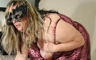 Big mama masturbating on their way bed