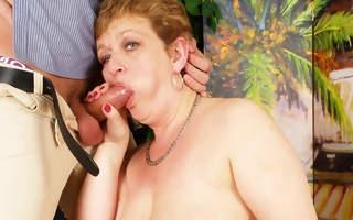 Offbeat housewife playing with her kickshaw boy