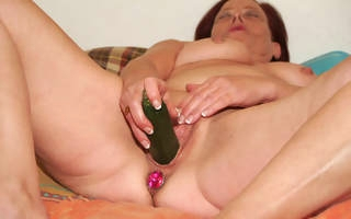 This mature battleaxe loves to play with her own pussy