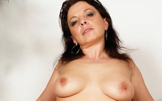 This horny mature slut loves a younger horseshit inside her